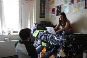 students in dorm on laptop