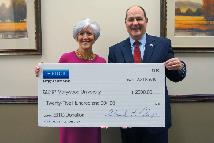 FNCB Bank presents a $2,500 Education Improvement Tax Credit (EITC) check to Marywood